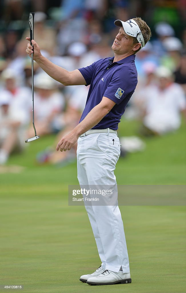 Luke Donald of England reacts to a putt during the third round of the Nedbank Golf Challenge at Gary Player CC on December 7 2013 in Sun City South...