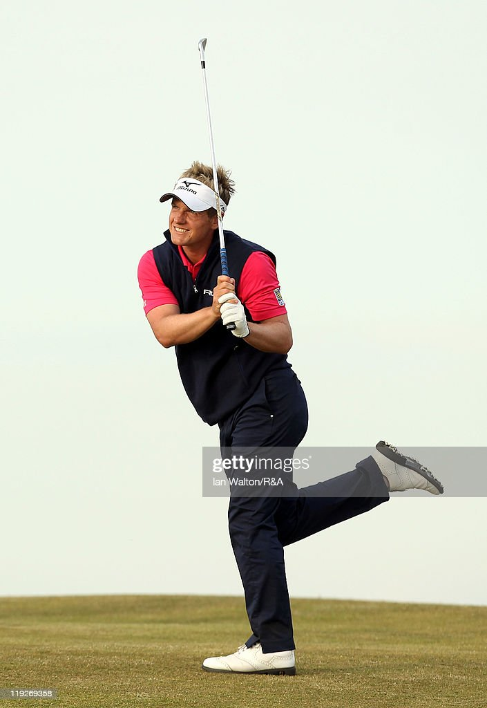 Luke Donald of England reacts to his second shot on the 18th hole during the second round of The 140th Open Championship at Royal St George's on July 15, 2011 in Sandwich, England.