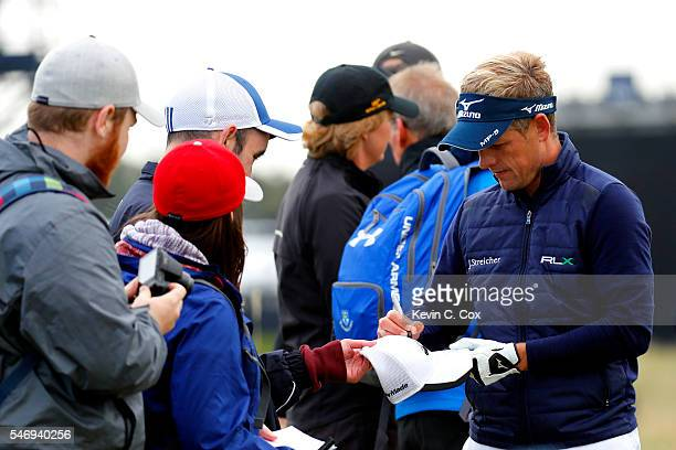 Luke Donald of England signs autographs during previews ahead of the 145th Open Championship at Royal Troon on July 13 2016 in Troon Scotland