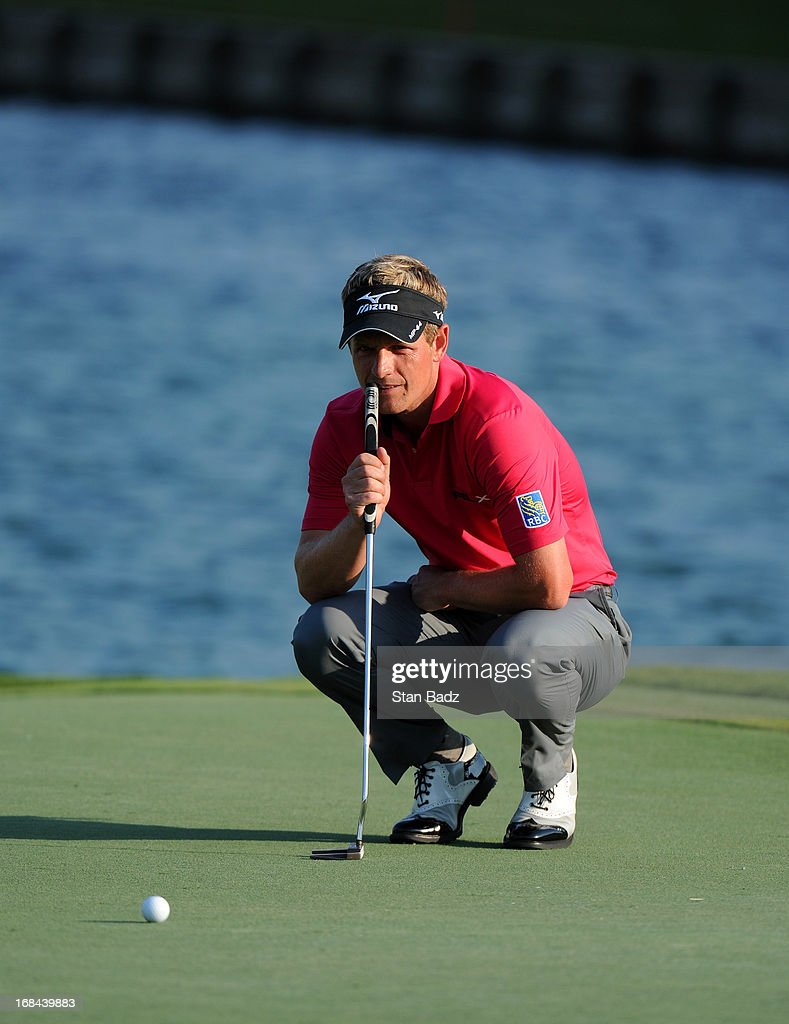 Luke Donald of England studies his putt on the 18th hole during the first round of THE PLAYERS Championship on THE PLAYERS Stadium Course at TPC Sawgrass on May 9, 2013 in Ponte Vedra Beach, Florida.