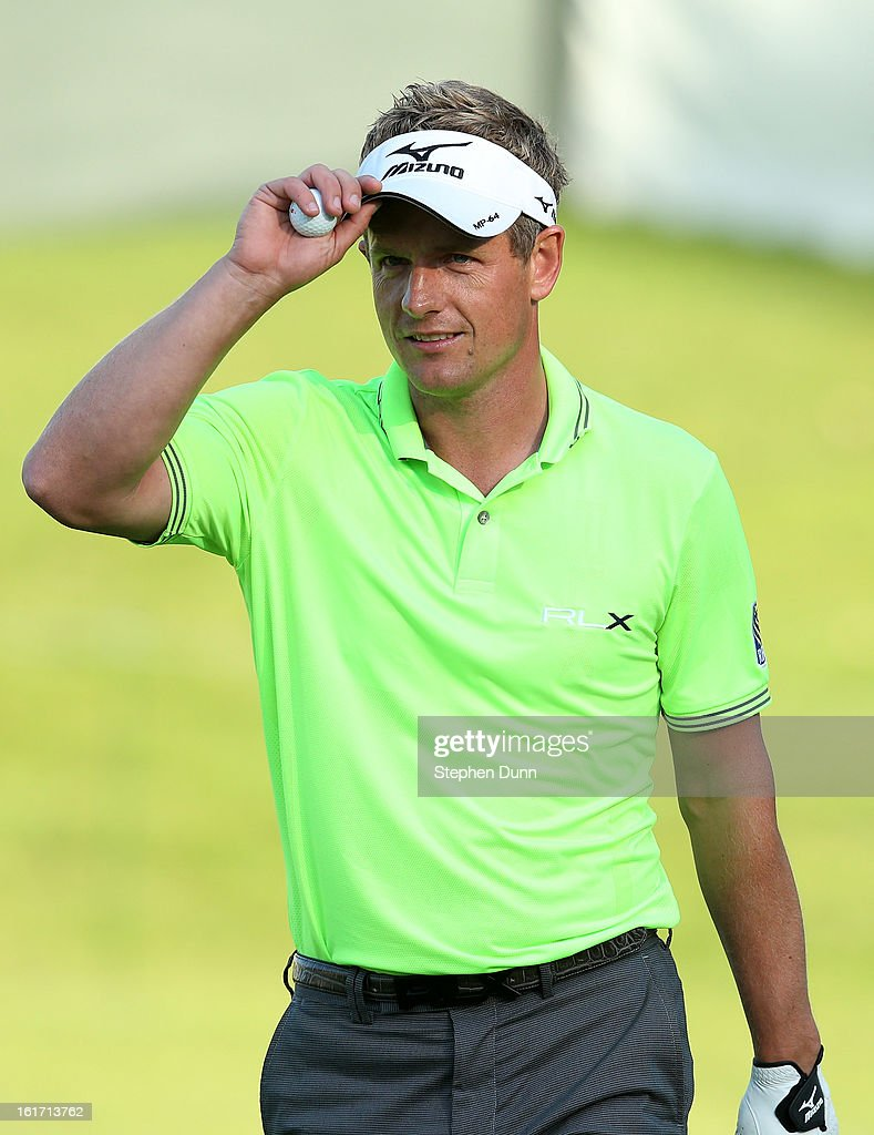 Luke Donald of England tips his visor after holing out from a bunker for a birdie two on the 14th hole during the first round of the Northern Trust Open at Riviera Country Club on February 14, 2013 in Pacific Palisades, California.