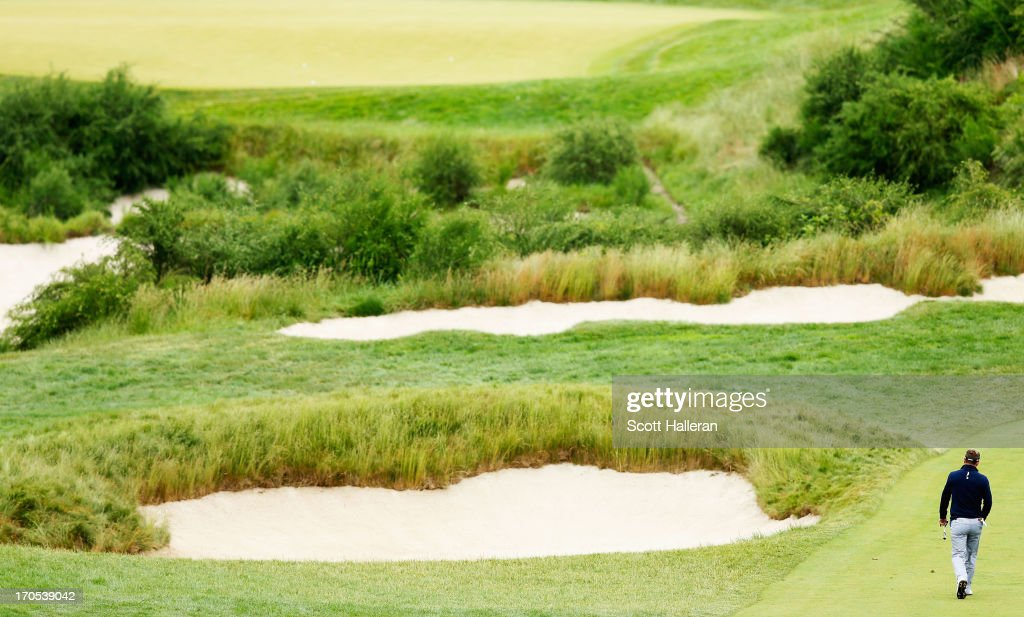 Luke Donald of England walks to the 16th green during a continuation of Round One of the 113th US Open at Merion Golf Club on June 14 2013 in Ardmore...