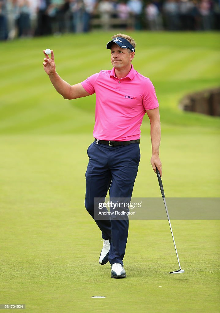 <a gi-track='captionPersonalityLinkClicked' href=/galleries/search?phrase=Luke+Donald&family=editorial&specificpeople=194977 ng-click='$event.stopPropagation()'>Luke Donald</a> of England waves on the 18th green during day two of the BMW PGA Championship at Wentworth on May 27, 2016 in Virginia Water, England.