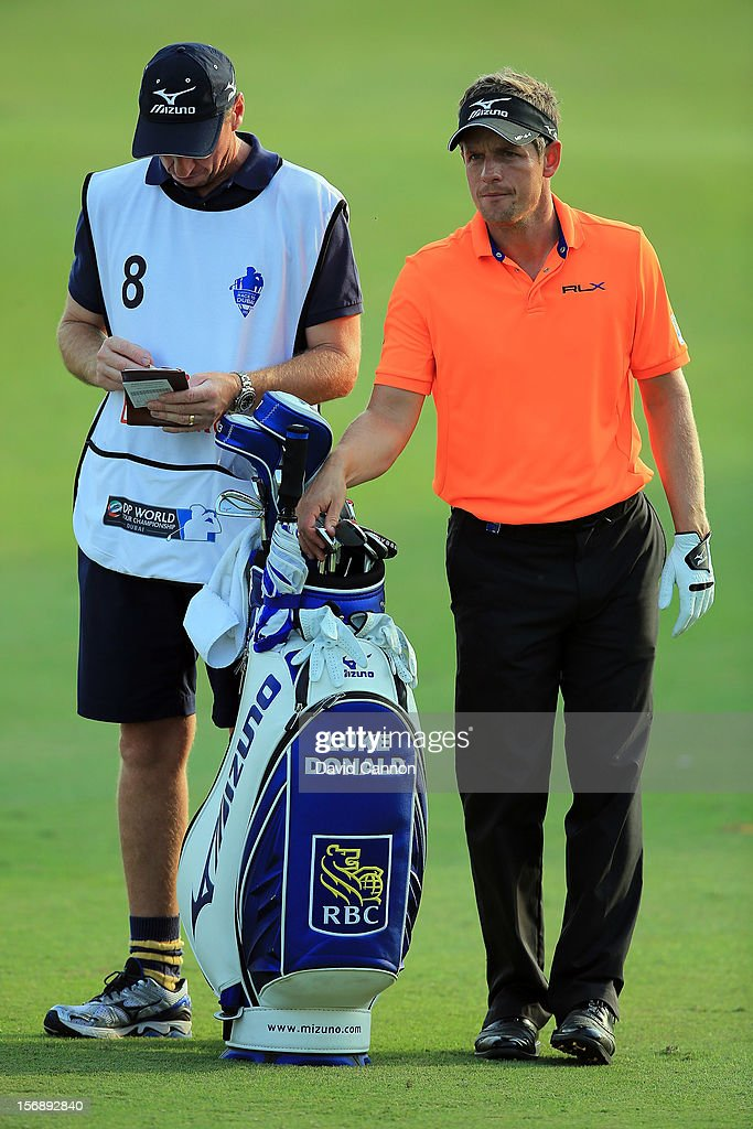 <a gi-track='captionPersonalityLinkClicked' href=/galleries/search?phrase=Luke+Donald&family=editorial&specificpeople=194977 ng-click='$event.stopPropagation()'>Luke Donald</a> of England with his caddie John McLaren before his second shot at the par 4, 15th hole during the third round of the 2012 DP World Tour Championship on the Earth Course at Jumeirah Golf Estates on November 24, 2012 in Dubai, United Arab Emirates.
