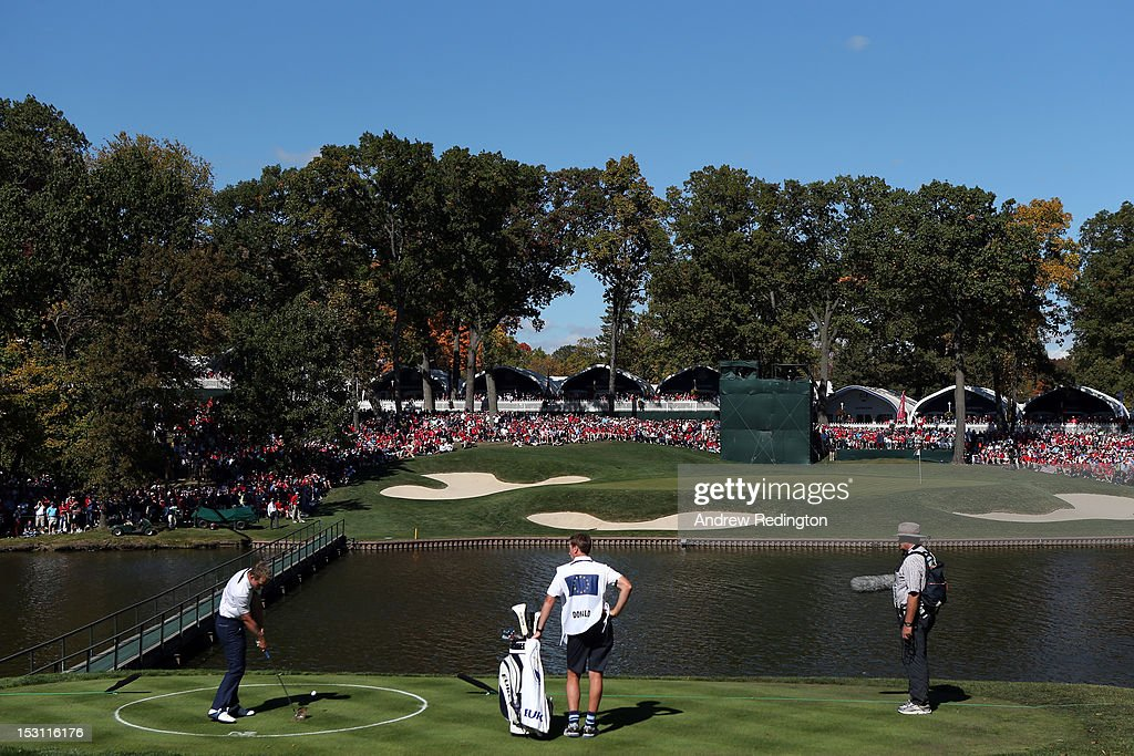 Luke Donald of Europe hits from the drop zone on the 13th hole during the Singles Matches for The 39th Ryder Cup at Medinah Country Club on September...