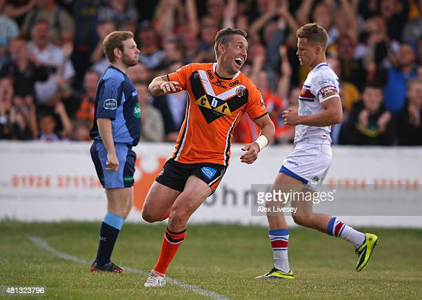 Luke Dorn of Castleford Tigers celebrates after scoring his second try during the First Utility Super League match between Wakefield Trinity Wildcats...