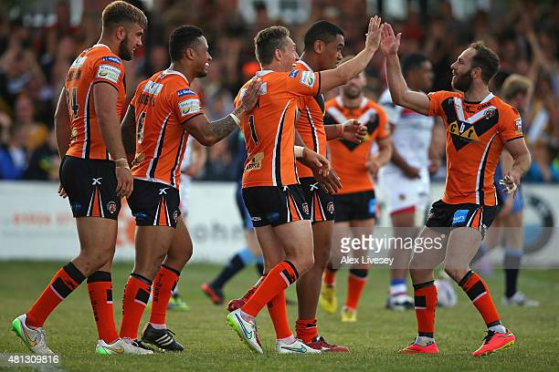 Luke Dorn of Castleford Tigers celebrates with Luke Gale after scoring his second try during the First Utility Super League match between Wakefield...