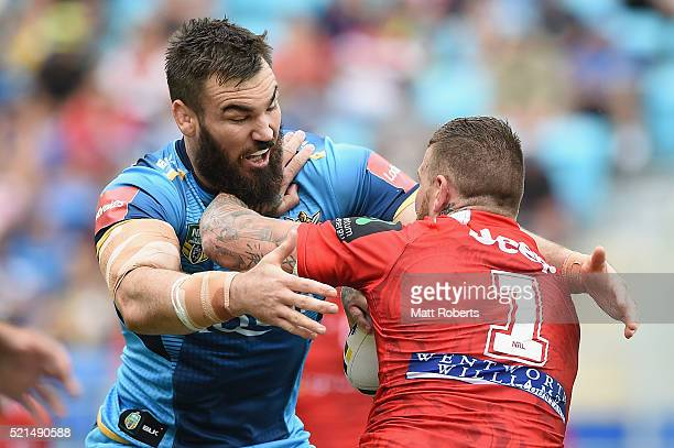 Luke Douglas of the Titans tackles Josh Dugan of the Dragons during the round seven NRL match between the Gold Coast Titans and the St George...