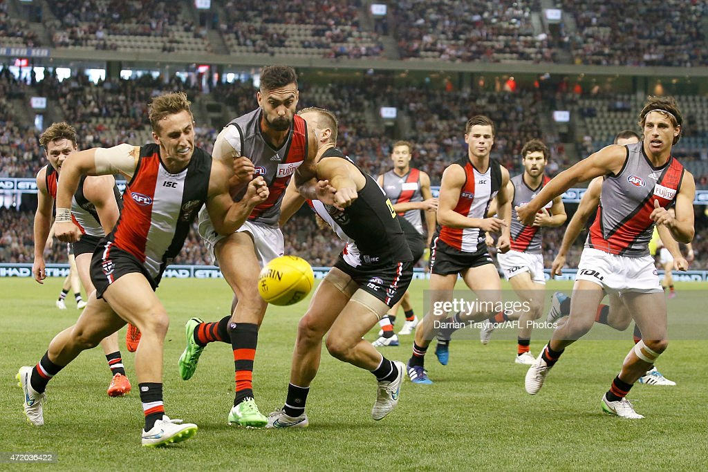 Luke Dunstan and David Armitage of the Saints tackle Courtenay Dempsey of the Bombers during the round five AFL match between the St Kilda Saints and...
