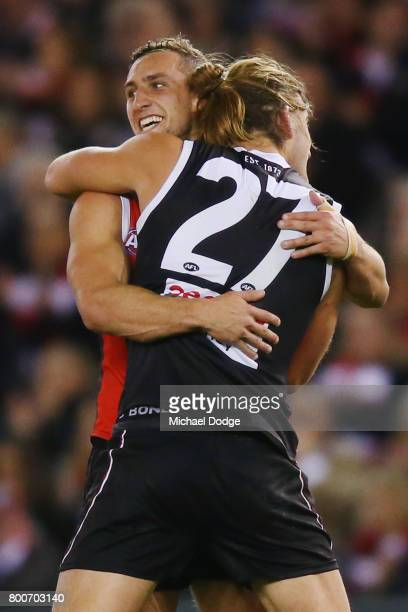 Luke Dunstan and Josh Bruce of the Saints celebrates a goal during the round 14 AFL match between the St Kilda Saints and the Gold Coast Suns at...