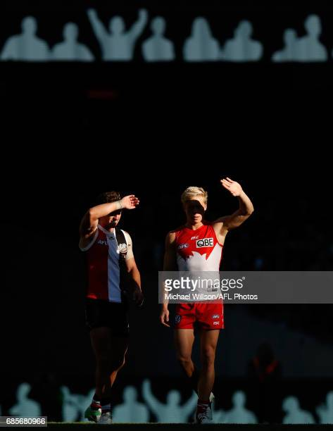 Luke Dunstan of the Saints and Isaac Heeney of the Swans shield their eyes from the sun during the 2017 AFL round 09 match between the St Kilda...