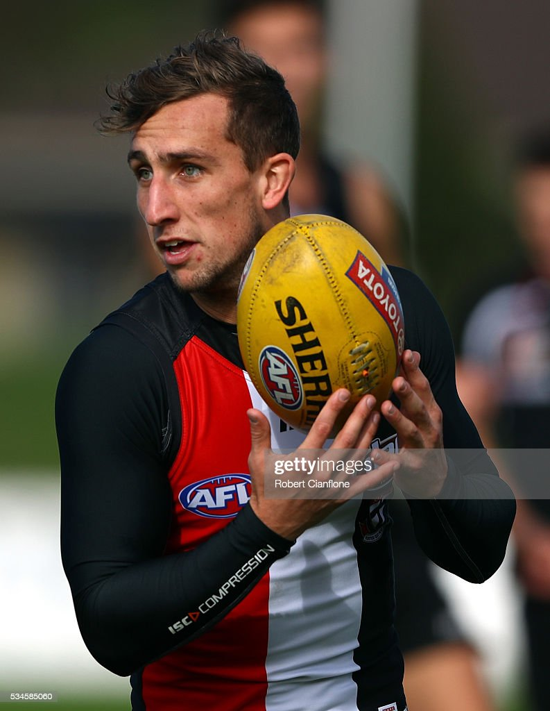 Luke Dunstan of the Saints controls the ball during a St Kilda Saints AFL training session at Moorabbin Oval on May 27, 2016 in Melbourne, Australia.