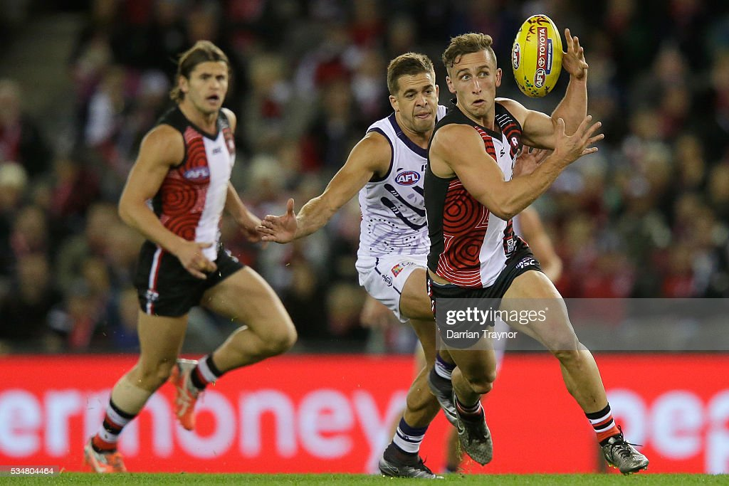 Luke Dunstan of the Saints gathers the ball during the round 10 AFL match between the St Kilda Saints and the Fremantle Dockers at Etihad Stadium on May 28, 2016 in Melbourne, Australia.