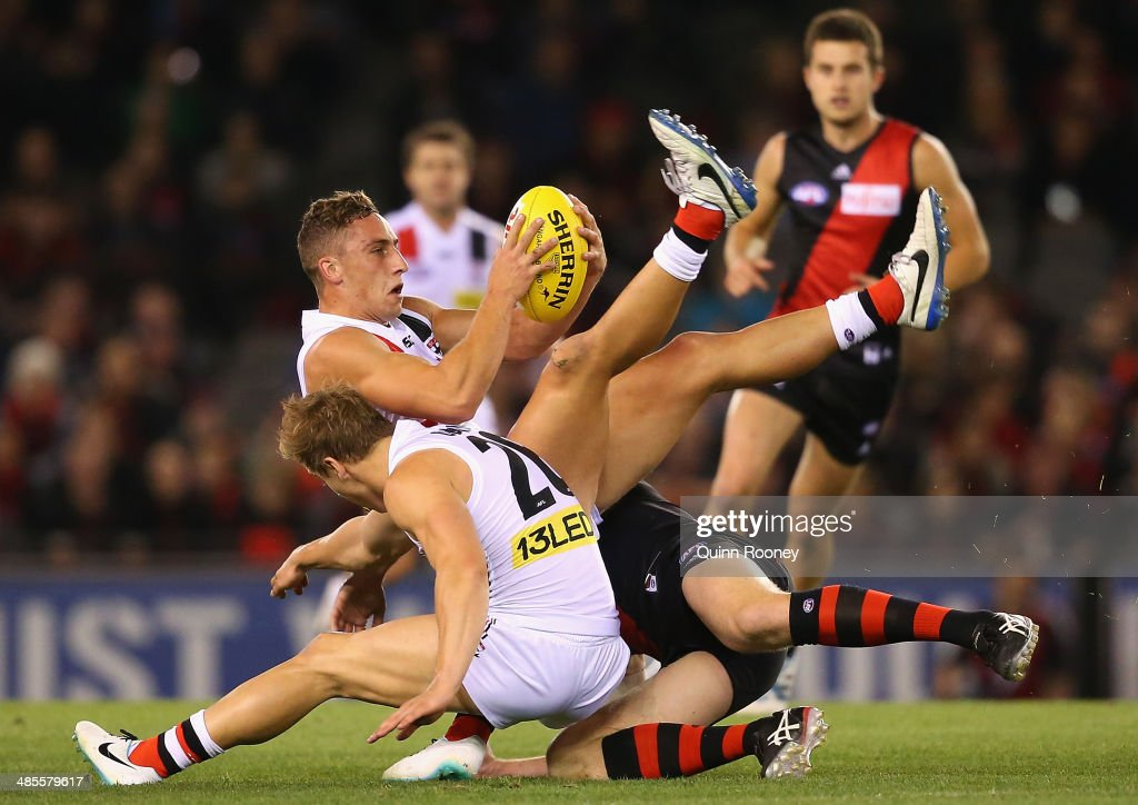 Luke Dunstan of the Saints is tackled during the round five AFL match between the Essendon Bombers and the St Kilda Saints at Etihad Stadium on April 19, 2014 in Melbourne, Australia.
