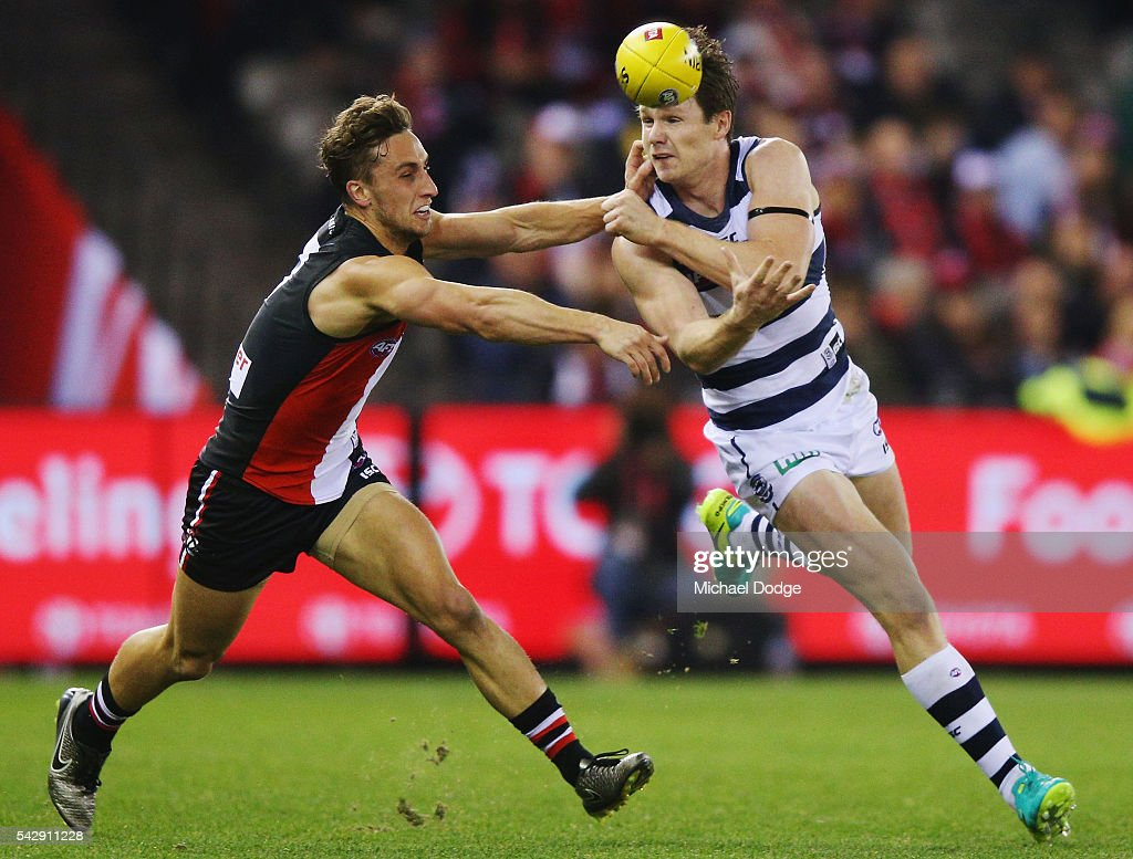 Luke Dunstan of the Saints smothers the handball of <a gi-track='captionPersonalityLinkClicked' href=/galleries/search?phrase=Patrick+Dangerfield&family=editorial&specificpeople=4479400 ng-click='$event.stopPropagation()'>Patrick Dangerfield</a> of the Cats during the round 14 AFL match between the St Kilda Saints and the Geelong Cats at Etihad Stadium on June 25, 2016 in Melbourne, Australia.