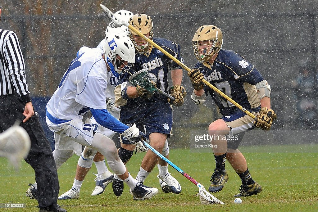 Luke Duprey #91 of the Duke Blue Devils gets a ground ball against the Notre Dame Fighting Irish at Koskinen Stadium on February 16, 2013 in Durham, North Carolina. Notre Dame defeated Duke 13-5.