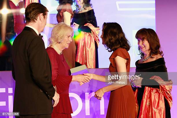 Luke Ellis Camilla Duchess of Cornwall and Helena Kennedy QC present shortlisted author Ottessa Moshfegh with a copy of her book 'Eileen' at the 2016...