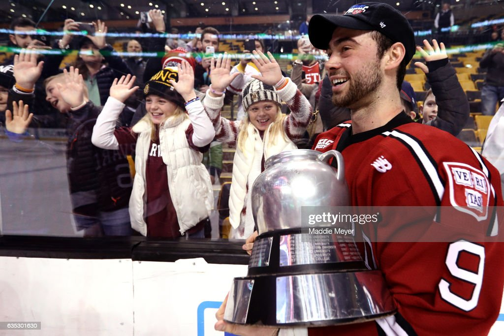 Luke Esposito #9 of the Harvard Crimson celebrates with young fans after defeating the Boston University Terriers 6-3 in the 2017 Beanpot Tournament Championship at TD Garden on February 13, 2017 in Boston, Massachusetts.