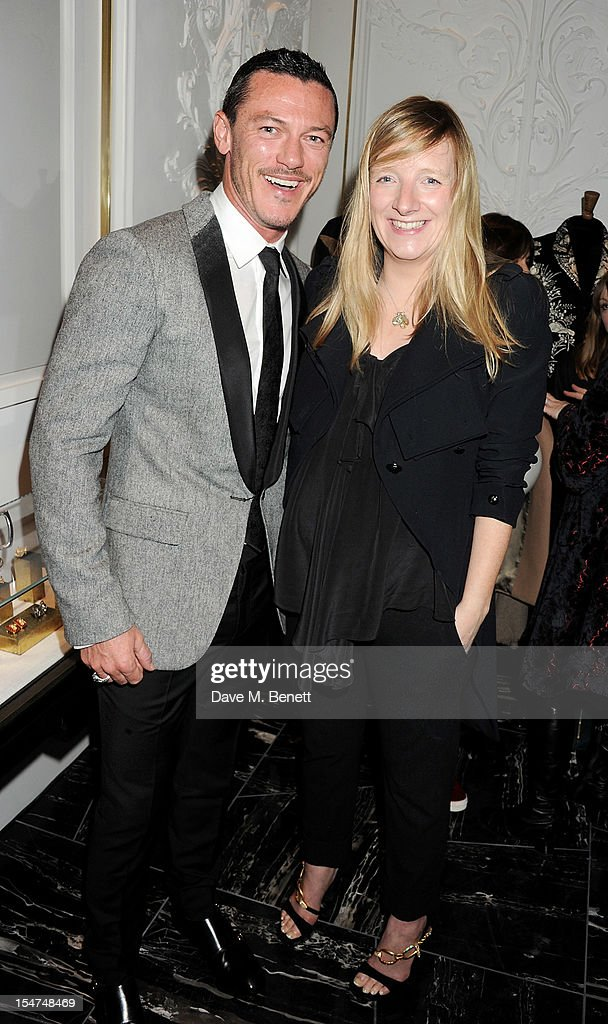 Luke Evans (L) and Alexander McQueen Creative Director Sarah Burton attend the launch of the Alexander McQueen Menswear boutique on Savile Row on October 25, 2012 in London, England.