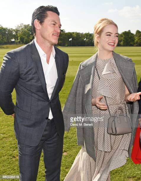Luke Evans and Emma Stone attend the Audi Polo Challenge at Coworth Park on May 7 2017 in Ascot United Kingdom