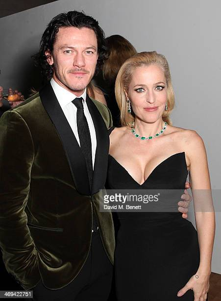 Luke Evans and Gillian Anderson at the WilliamVintage dinner in partnership with American Express at St Pancras Renaissance Hotel on February 14 2014...