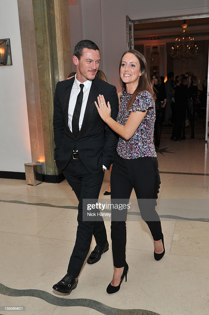 Luke Evans and guest attend the Harper's Bazaar Woman of the Year Awards at Claridge's Hotel on October 31, 2012 in London, England.