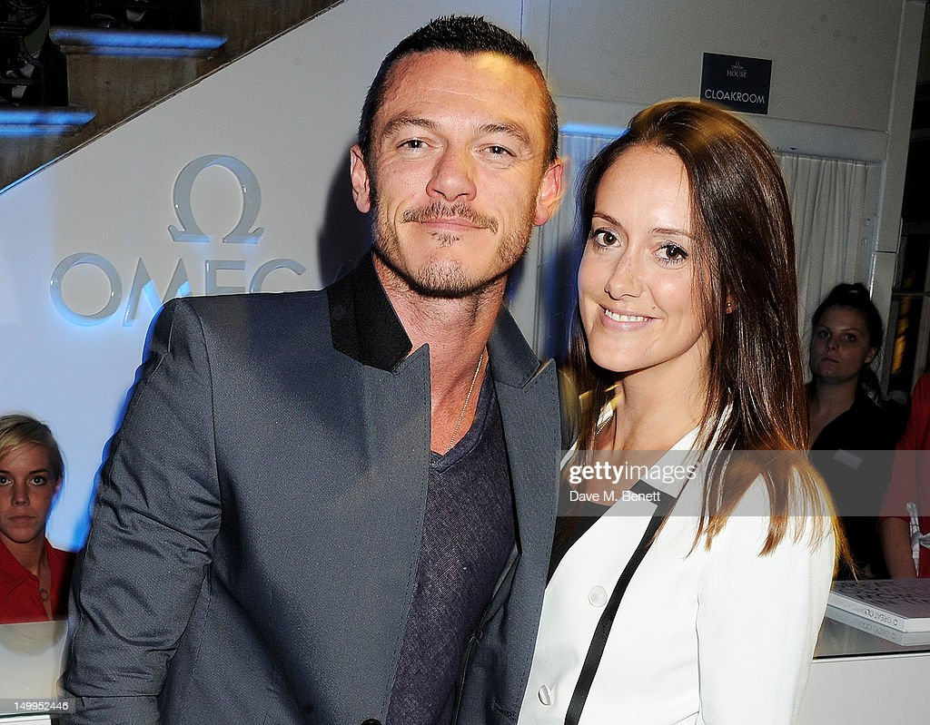 Luke Evans (L) and Holly Goodchild attend 'Spotlight On Swimming' at OMEGA House, OMEGA's official residence during the London 2012 Olympic Games, at The House of St. Barnabas on August 7, 2012 in London, England.