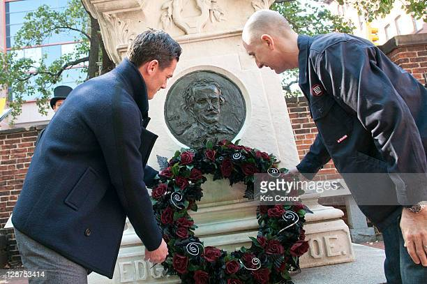 Luke Evans and James McTeigue lay a wreath on the grave of Edgar Allan Poe on the 162nd anniversary of his death at Westminster Hall on October 7...