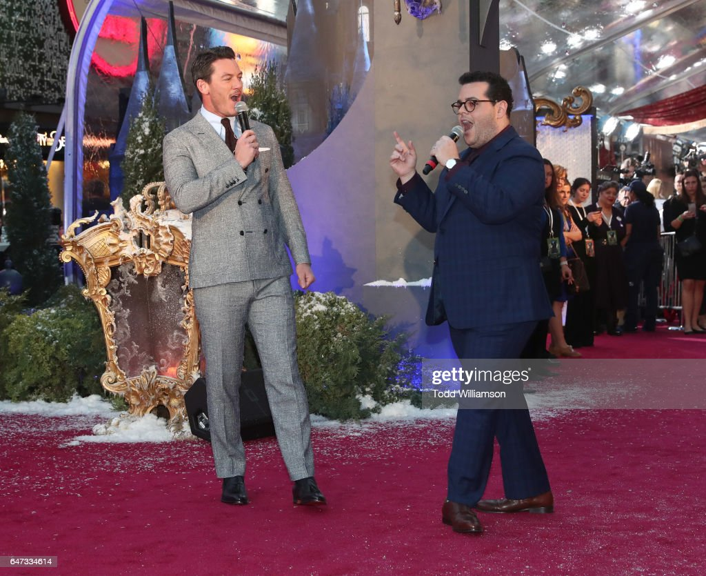 Luke Evans and Josh Gad sing a song at the premiere of Disney's 'Beauty And The Beast' at El Capitan Theatre on March 2, 2017 in Los Angeles, California.