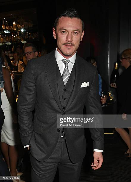 Luke Evans attends the GQ and Hackett PreBAFTA party celebrating Hackett's fifth year as the Official Menswear Stylist to the EE British Academy Film...