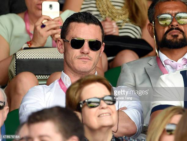 Luke Evans attends the Philipp Kohlschreiber v Novak Djokovic match on day one of the Wimbledon Tennis Championships on June 29 2015 in London England
