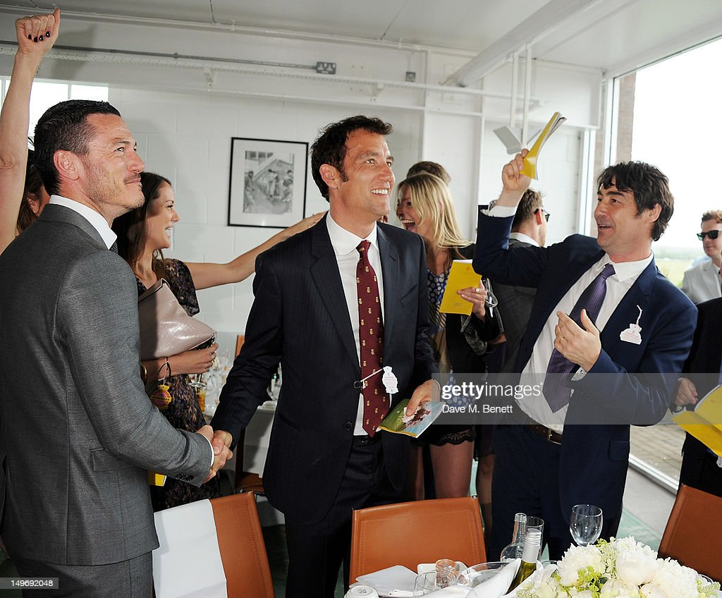 Luke Evans, Clive Owen and Nat Parker attend Ladies Day at Glorious Goodwood held at Goodwood Racecourse on August 2, 2012 in Chichester, England.