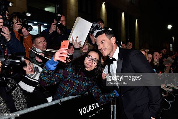 Luke Evans takes selfies as he arrives at the GQ Men of the year Award 2016 at Komische Oper on November 10 2016 in Berlin Germany