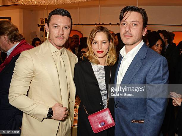 Luke Evans wearing a Bulgari watch Sienna Guillory carrying a Bulgari bag and Enzo Cilenti attend the Bulgari flagship store reopening on New Bond...