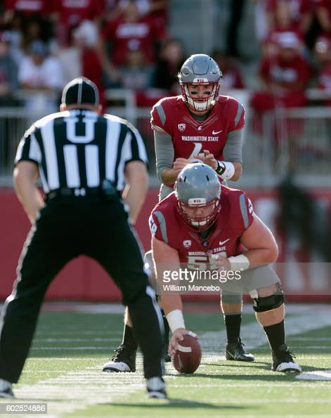 Luke Falk of the Washington State Cougars calls out signals before the snap from Riley Sorenson during the game against the Eastern Washington Eagles...