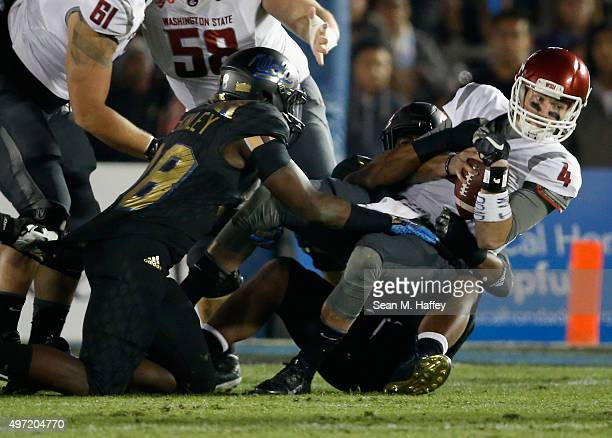 Luke Falk of the Washington State Cougars is sacked by Takkarist McKinley of the UCLA Bruins during the first quarter of a game at Rose Bowl on...