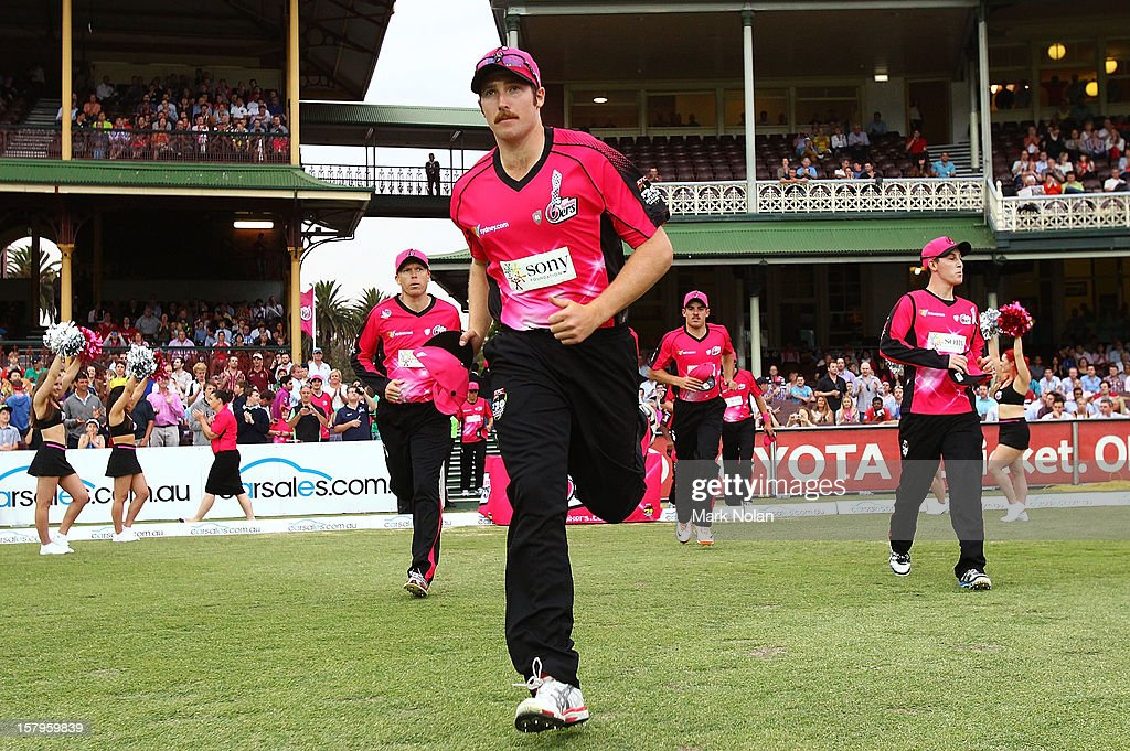 Luke Feldman of the Sixers runs out onto the field before the Big Bash League match between the Sydney Sixers and the Sydney Thunder at Sydney Cricket Ground on December 8, 2012 in Sydney, Australia.