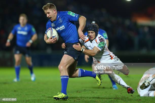 Luke Fitzgerald of Leinster is challenged by Matheew Morgan of Ospreys during the Heineken Cup Pool One match between |Leinster and Ospreys at the...