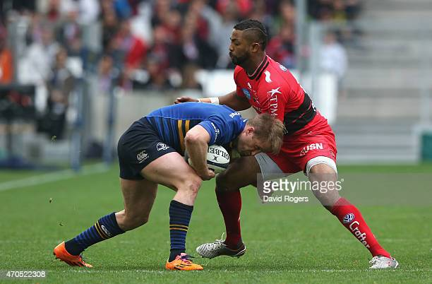 Luke Fitzgerald of Leinster is tackled by Delon Armitage during the European Rugby Champions Cup semi final match between RC Toulon and Leinster at...