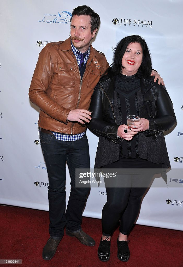 Luke Ford and April Scott attend The Realm Creative red carpet premier party on February 16, 2013 in Los Angeles, California.