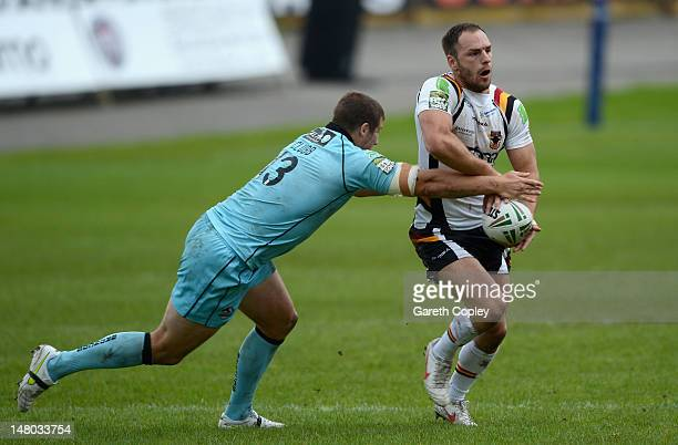 Luke Gale of Bradford is tackled by Tony Clubb of London during the Stobart Superleague match between Bradford Bulls and London Broncos at Odsal...