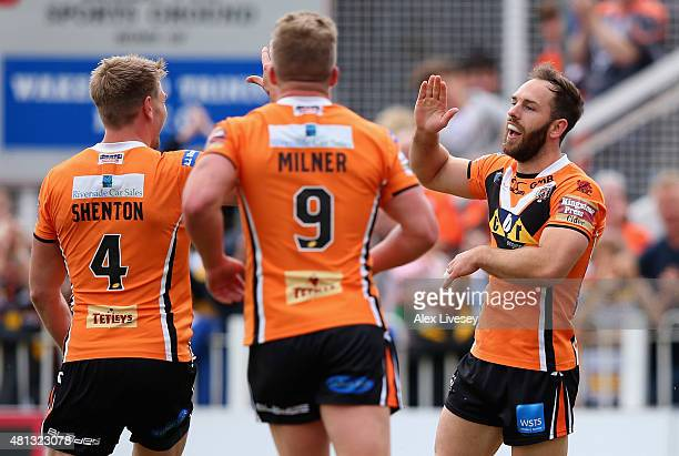 Luke Gale of Castleford Tigers celebrates after scoring the second try during the First Utility Super League match between Wakefield Trinity Wildcats...