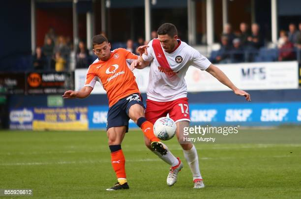 Luke Gambin of Luton Town and Ben Tozer of Newport County battle for possession during the Sky Bet League Two match between Luton Town and Newport...