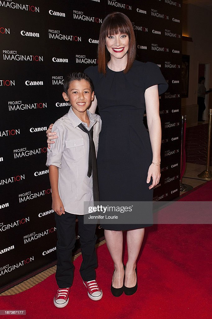 Luke Ganalon and <a gi-track='captionPersonalityLinkClicked' href=/galleries/search?phrase=Bryce+Dallas+Howard&family=editorial&specificpeople=156411 ng-click='$event.stopPropagation()'>Bryce Dallas Howard</a> attend the Los Angeles screening for Canon's 'Project Imaginat10n' film festival at Pacific Theatre at The Grove on November 7, 2013 in Los Angeles, California.