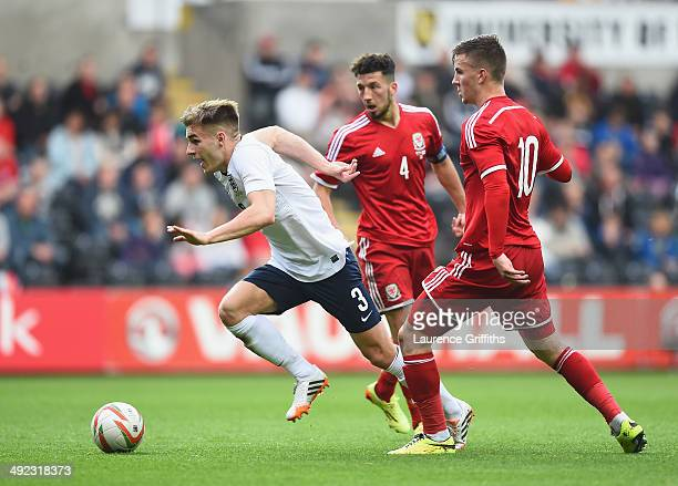 Luke Garbutt of England breaks away from Lee Lucas of Wales during the 2015 UEFA European U21 Championships Qualifier between Wales and England at...