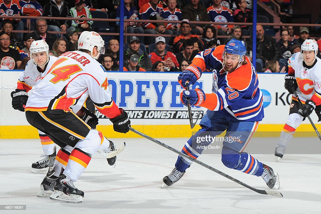 Luke Gazdic #20 of the Edmonton Oilers battles for the puck against Chris Butler #44 of the Calgary Flames on March 22, 2014 at Rexall Place in Edmonton, Alberta, Canada.