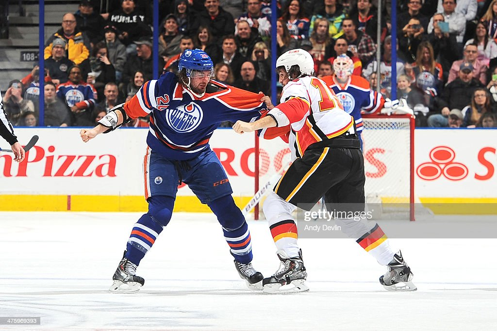<a gi-track='captionPersonalityLinkClicked' href=/galleries/search?phrase=Luke+Gazdic&family=editorial&specificpeople=4754039 ng-click='$event.stopPropagation()'>Luke Gazdic</a> #20 of the Edmonton Oilers fights <a gi-track='captionPersonalityLinkClicked' href=/galleries/search?phrase=Kevin+Westgarth&family=editorial&specificpeople=4537296 ng-click='$event.stopPropagation()'>Kevin Westgarth</a> #15 of the Calgary Flames on March 1, 2014 at Rexall Place in Edmonton, Alberta, Canada.