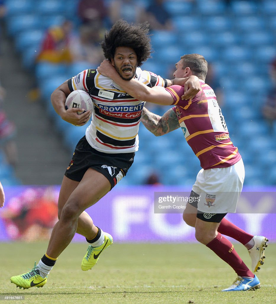 Luke George of Bradford Bulls is tackled by Danny Brough of Huddersfield Giants during the Super League match between Huddersfield Giants and Bradford Bulls at Etihad Stadium on May 18, 2014 in Manchester, England.