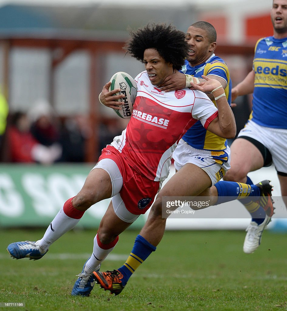 Luke George of Hull KR is tacked by <a gi-track='captionPersonalityLinkClicked' href=/galleries/search?phrase=Kallum+Watkins&family=editorial&specificpeople=5313967 ng-click='$event.stopPropagation()'>Kallum Watkins</a> of Leeds during the Super League match between Hull Kingston Rovers and Leeds Rhinos at Craven Park Stadium on April 28, 2013 in Hull, England.