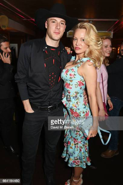 Luke Gilford and Pamela Anderson attend the launch of the Coco De Mer Icons Collection at Albert's Club on April 3 2017 in London England